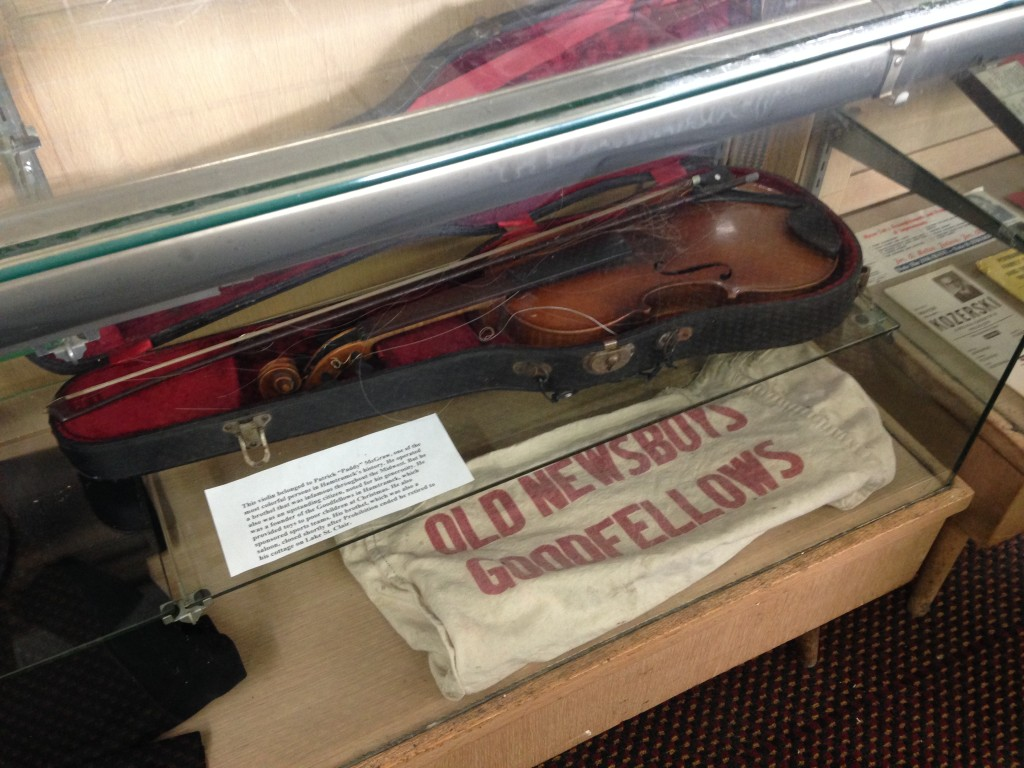Here's his violin and an original Newsboys Goodfellows collection bag. At the Hamtramck Historical Museum. You should go there.